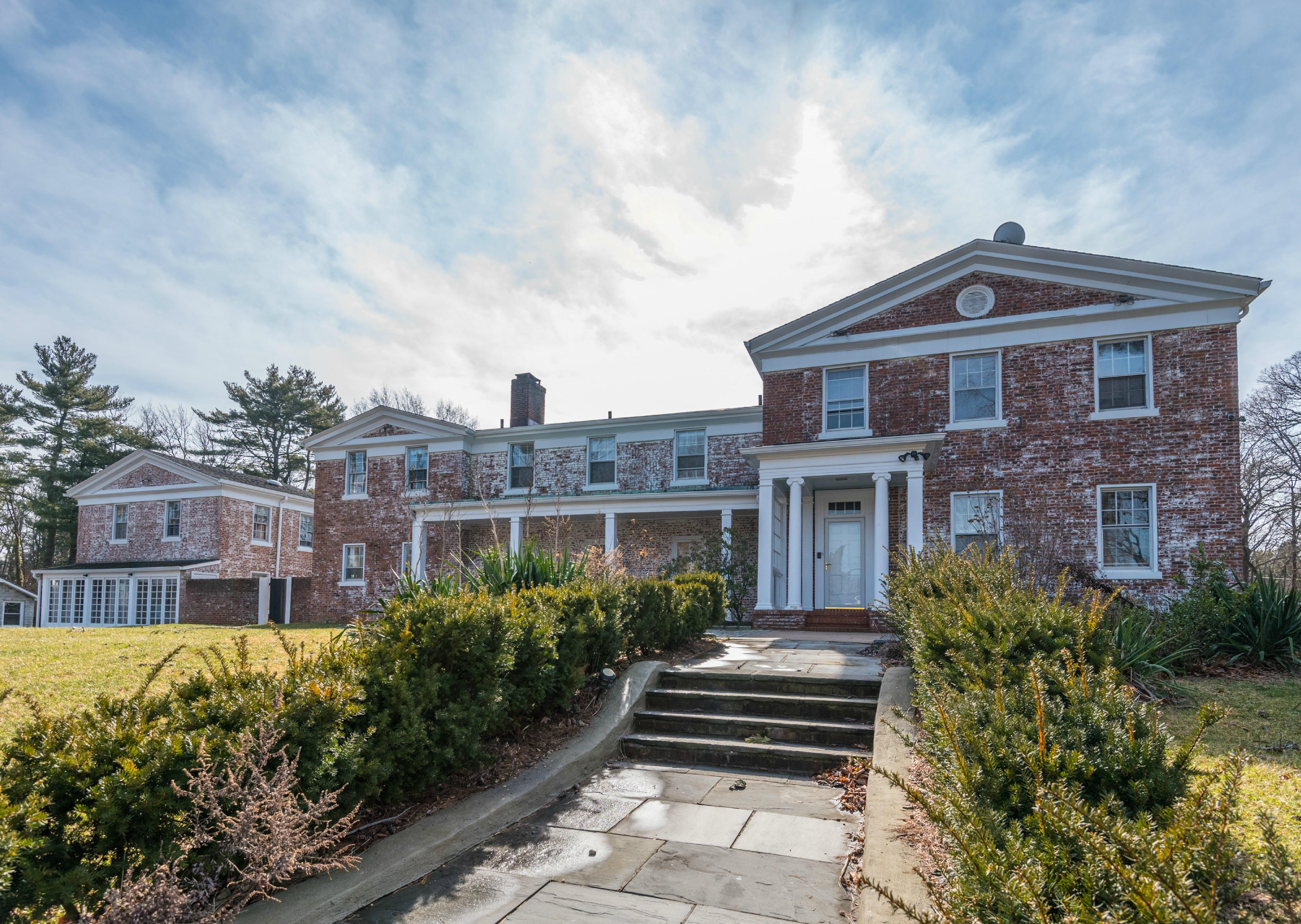 Price Improved!  Charming white-washed brick manor in the heart of old westbury