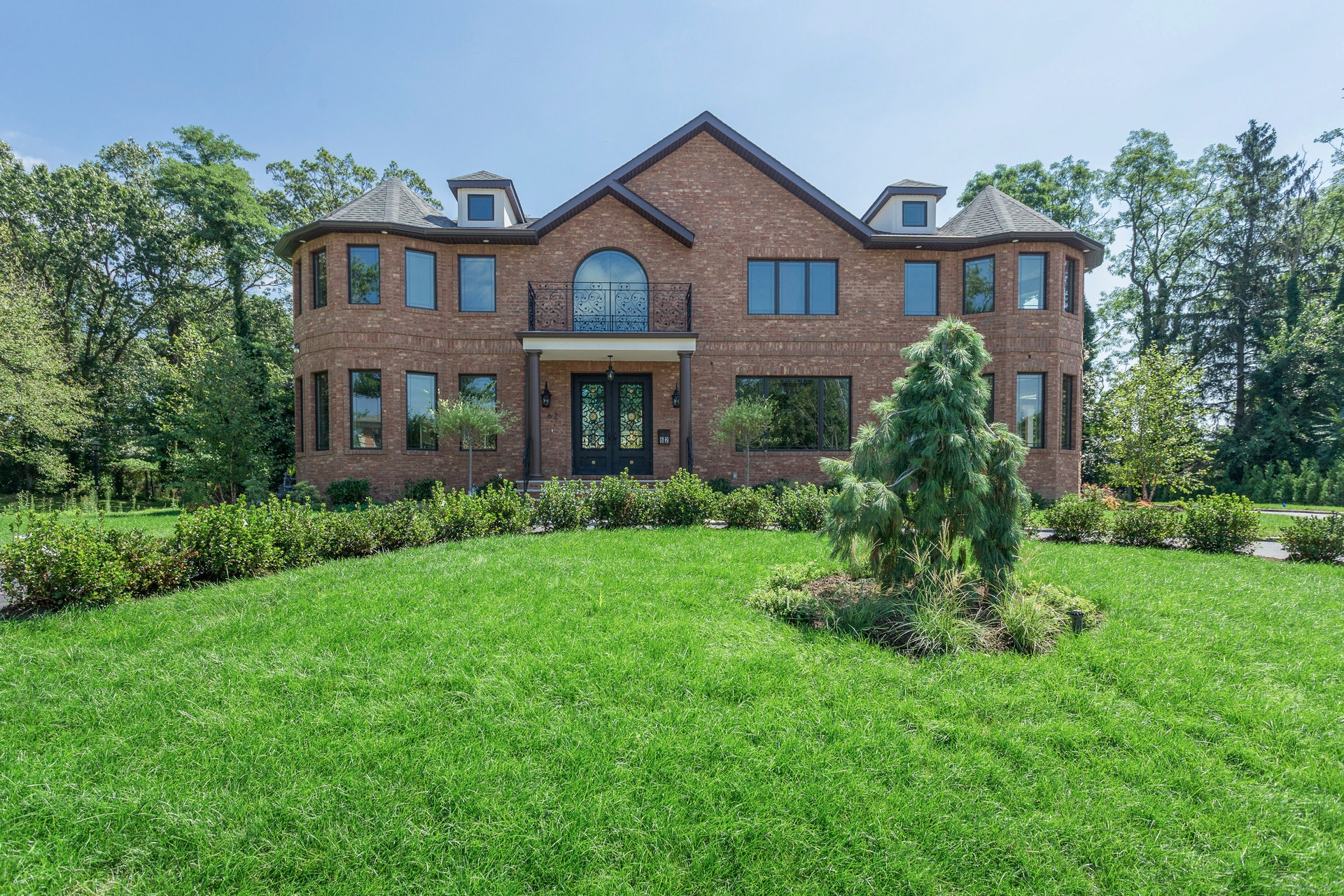 Brand New Brick Colonial Overlooking the rolling fairways of Wheatley Hills golf course