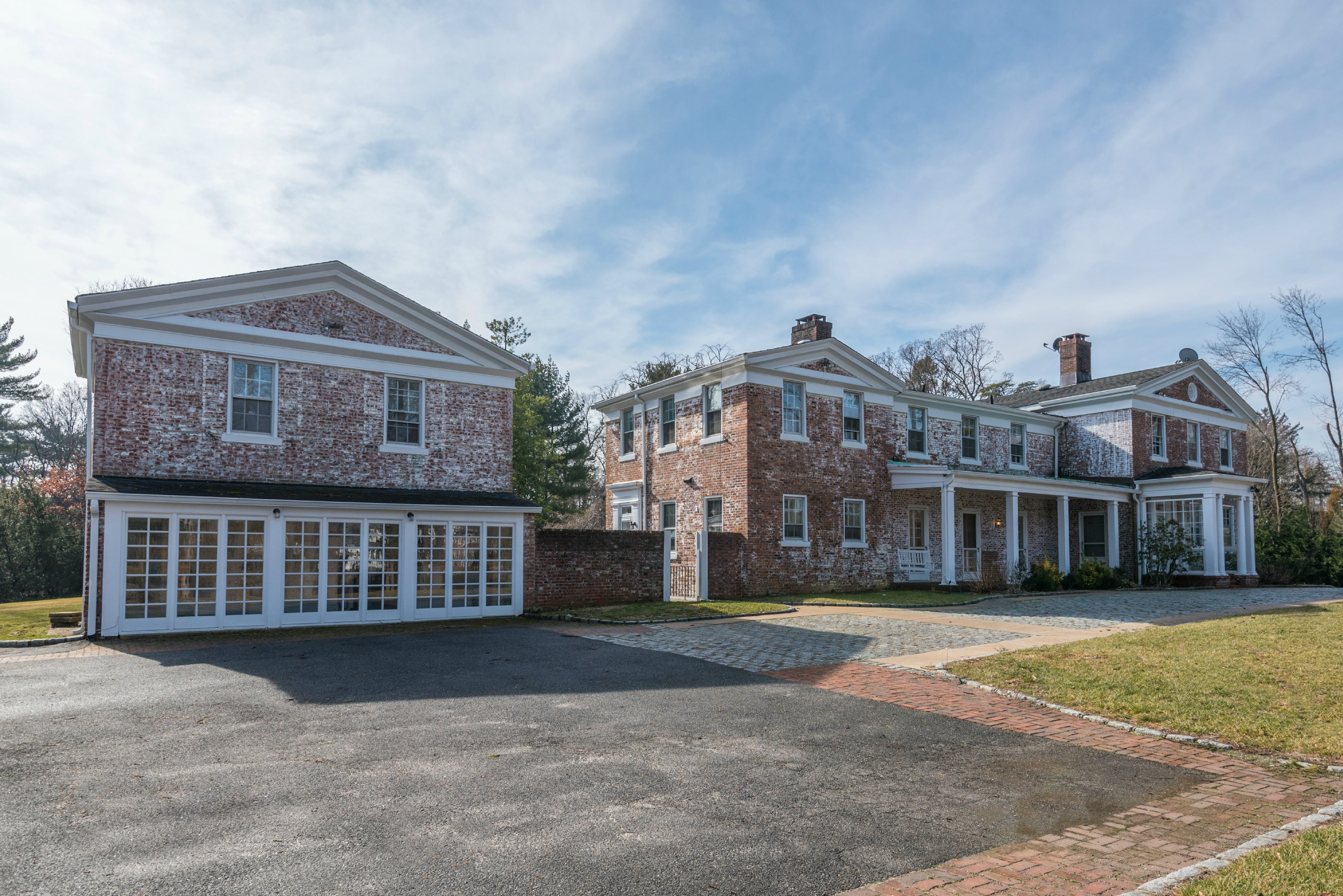 Back on the market!  Charming White Washed Brick Country Estate