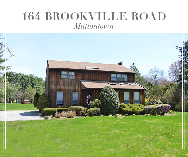 Price Improved!  Peaceful and private Colonial home set on over 2 lush acres in Muttontown