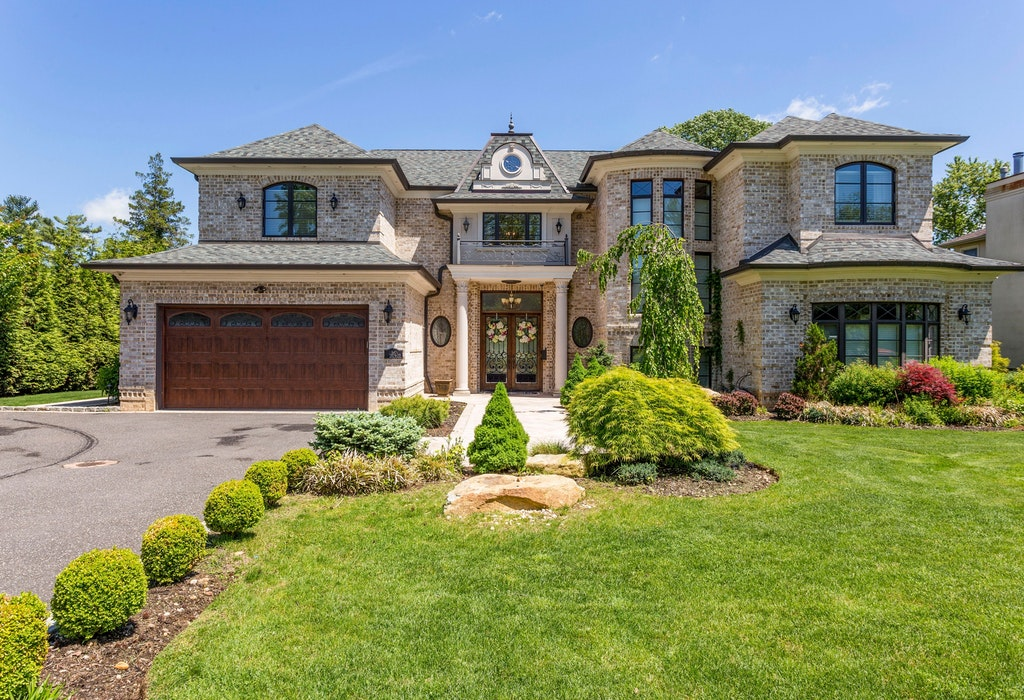 Just Listed!  Incomparable French Country Colonial in Roslyn Country Club