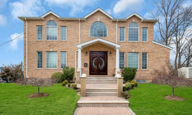 Under Contract in 21 Days!  Custom Built Brick Colonial on Oversized Corner Lot in Albertson