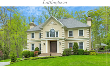 Just Listed!  Stately Young Stucco Colonial on 2 Private Acres in Lattingtown