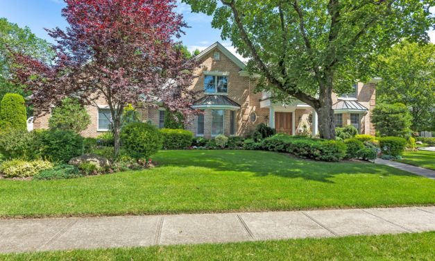 Price Improved!  Regal Brick Colonial in Roslyn Country Club